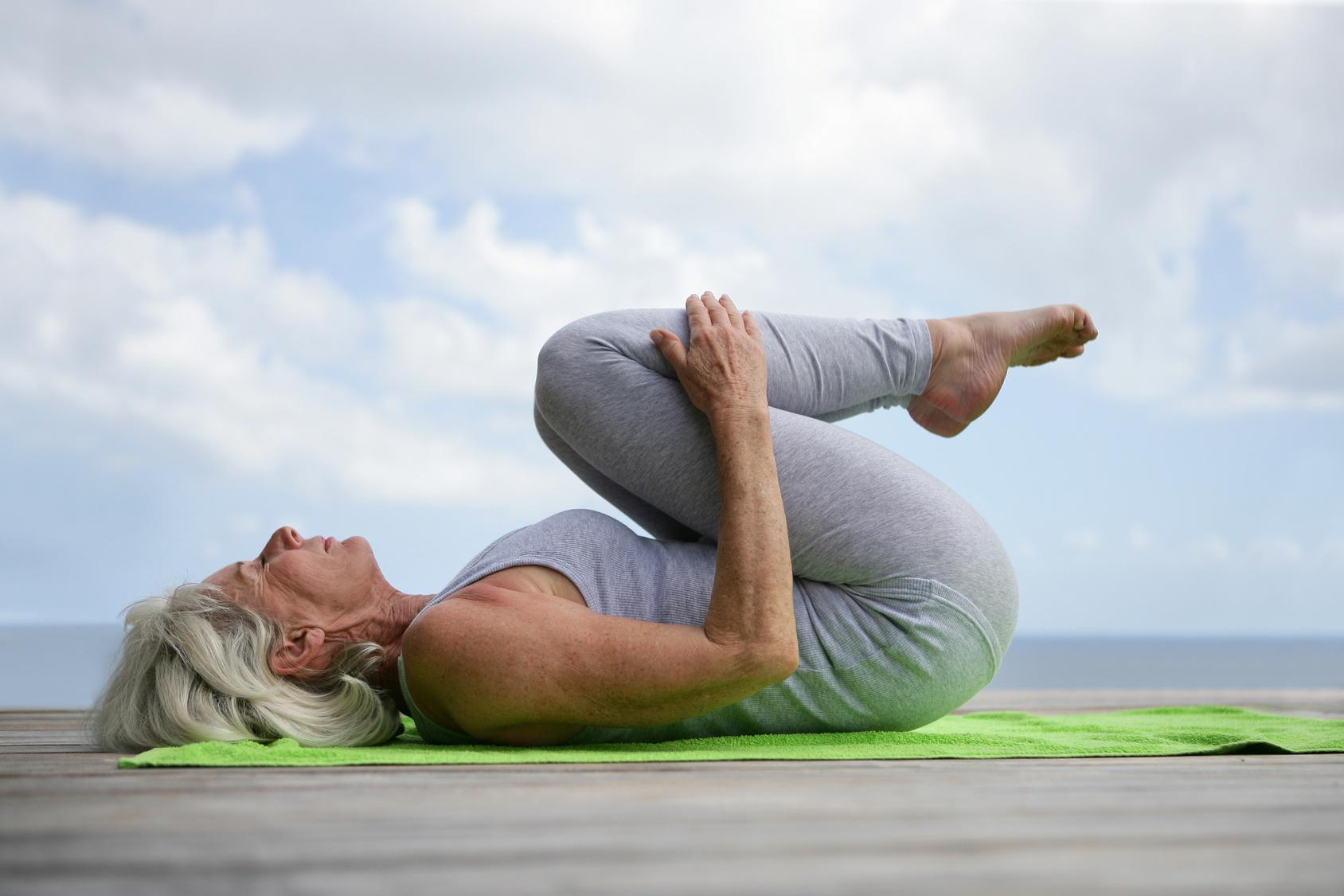 woman-doing-yoga-on-jetty